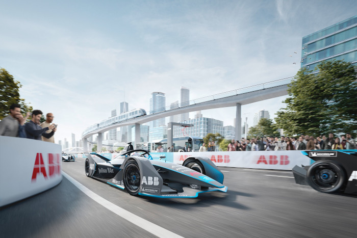 Excited audience watching electric racing car on racetrack